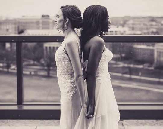 Brides Standing Back to Back