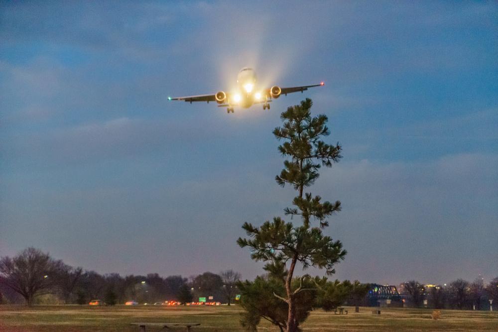 Plane lands at Ronald Reagan Washington National Airport Gravelly Point at night