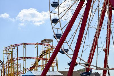 Amusement park rides at a boardwalk